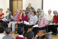 The Bach Choir laugh with the children at a workshop