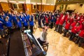 December 2012: Children from Outreach schools warm up ahead of a session singing with The Bach Choir